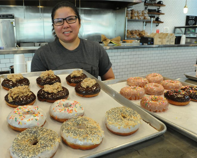 Pastry chef Haidee Contreras displays some of the new flavors of doughnuts she makes every Saturday morning at Scratch Sandwich Counter, located inside The Annex Food Hall at The Collection at RiverPark. The Oxnard restaurant is one of dozens set to participate in the Star's Wine & Food Experience Nov. 10 in Camarillo.