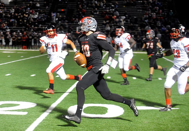 Vineland QB, Ryan Shelton (10) runs for a gain against visiting Trenton Central. The Fighting Clan defeated the Tornadoes 20-14 on Friday, September 28, 2018.