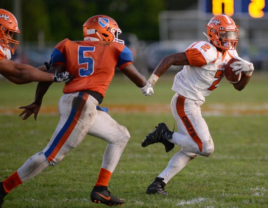 Cherokee's EJ Bard carries the ball during Friday night's game against Millville at Millville Senior High School, Sept. 28, 2018.