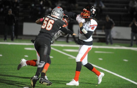Vineland MLB, Josue Delgado Jr., (56) goes after Trenton Central QB, Mahsiah Mcrae (8). The Fighting Clan defeated the Tornadoes 20-14 on Friday, September 28, 2018.