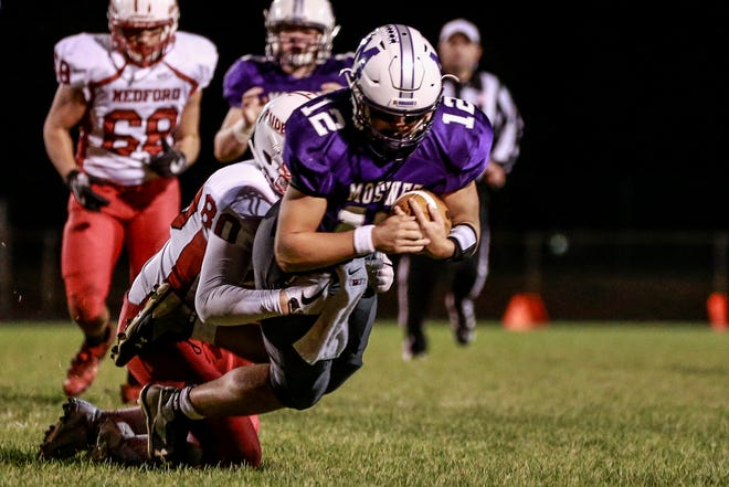 Mosinee's Trey Fitzgeraldl (12), front, gets tackle by Medford's Ethan Hahn (80) Friday, Sept. 28, 2018, during Great Northern Conference boys football game at Mosinee High School football field in Mosinee, Wis.