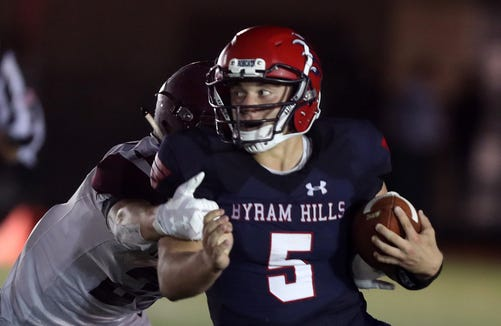 Byram Hills' Matthew Weiler (5) runs for a  touchdown against Harrison during first half action at Byram Hills High School in Armonk Sept. 28, 2018.
