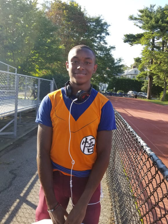 Albertus Magnus' Lavonno Mitchell after his team's win over Bronxville on Saturday, September 29th, 2018. His shirt is in the style of the Gi worn by the character Son Goku in the Dragon Ball anime series.