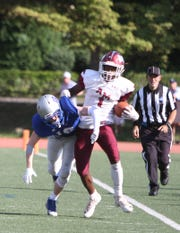 Albertus Magnus' Jaaron Joseph collides with Bronxville's Tommy O'Connell during a Section 1 football game at Bronxville on Saturday, September 29th, 2018. Albertus Magnus defeated Bronxville 42-16.