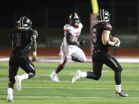 Nyack's Connor DiBlasi (6) intercepts the ball and pushes up the field during football game at Nyack High School on Sept. 28, 2018. Nyack defeats Spring Valley 21-20.