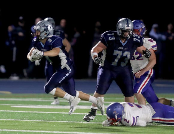 Brayden Rossi of John Jay East Fishkill rushes against Carmel during a varsity football game at John Jay East Fishkill Fishkill High School Sept. 28, 2018.