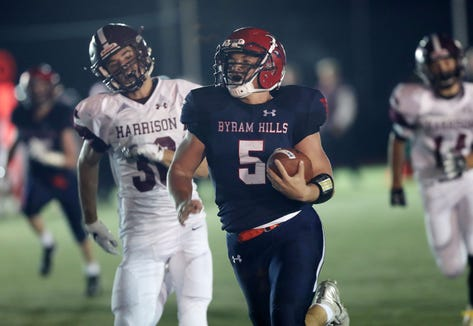 Byram Hills' Matthew Weiler (5) runs for a first half touchdown against Harrison during first half action at Byram Hills High School in Armonk Sept. 28, 2018.