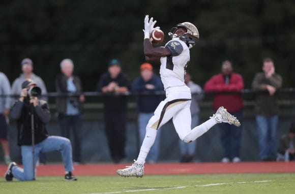 Clarkstown South's RJ Lamarre (6) pulls in a touchdown pass in their 28-7 win over Clarkstown North in the 20th playing of the supervisors cup at Clarkstown High School North in New City on Friday, September 28, 2018.