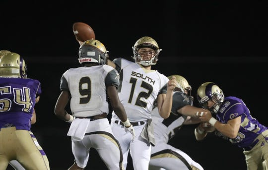 Clarkstown South quarterback Drew Tallevi (12) fires a pass during their 28-7 win over Clarkstown North in the 20th playing of the supervisors cup at Clarkstown High School North in New City on Friday, September 28, 2018.