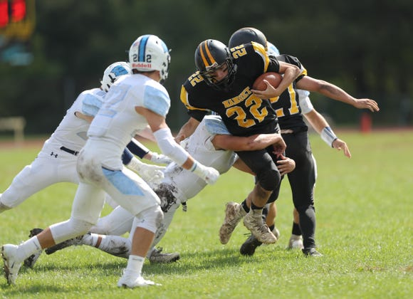 Nanuet's John Alicata (22) with the carry during their 14-0 win over Westlake at Nanuet High School on Saturday, September 29, 2018.