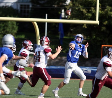 Bronxville's Clark Stephens makes a pass while under pressure from the Albertus Magnus defense during a Section 1 football game at Bronxville on Saturday, September 29th, 2018. Albertus Magnus defeated Bronxville 42-16.