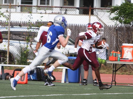 Albertus Magnus' Lavonno Mitchell runs away from the Bronxville defense during a Section 1 football game at Bronxville on Saturday, September 29th, 2018. Albertus Magnus defeated Bronxville 42-16.