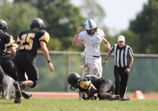 Westlake quarterback Thomas Carpenter (10) look on as Nanuet's Sunny Chavan (24) recovers a fumble during Nanuet's 14-0 win at Nanuet High School on Sept. 29.