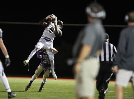 Clarkstown South's RJ Lamarre (6) pulls in a pass in their 28-7 win over Clarkstown North in the 20th playing of the supervisors cup at Clarkstown High School North in New City on Friday, September 28, 2018.