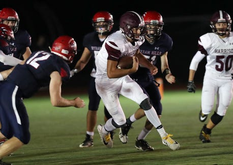 Harrison's Frank Nannariello (9) looks for some running room in the Byram Hills defense during first half action at Byram Hills High School in Armonk Sept. 28, 2018.