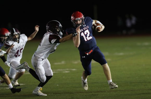 Byram Hills' Jack Kenny (12) shakes off a Harrison defender during first half action at Byram Hills High School in Armonk Sept. 28, 2018.