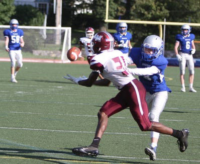 Albertus Magnus' Lavonno Mitchell beats Bronxville's Philip Meyers in one-on-one coverage for a touchdown reception during a Section 1 football game at Bronxville on Saturday, September 29th, 2018. Albertus Magnus defeated Bronxville 42-16.