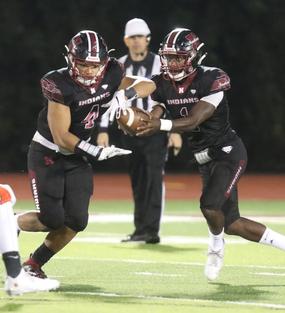 Nyack's Raylens Boutin (1) passes the ball to Tybarius Davis (4) during football game at Nyack High School on Sept. 28, 2018. Nyack defeats Spring Valley 21-20.