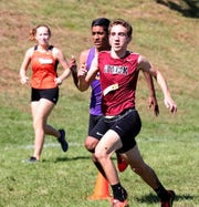 Nyack's Derek Wishner, front, and Clarkstown North's Shawn Kuriakose race to the finish during the boys varsity 2 race at the Fred Gressler Cross Country Run at White Plains High School, Sept. 29, 2018.