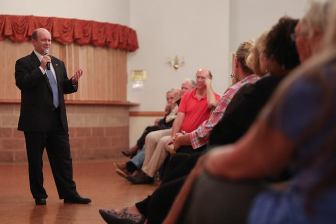 Sen. Chris Coons addresses constituents during a town hall at the Delaware City Volunteer Fire Company on Friday.