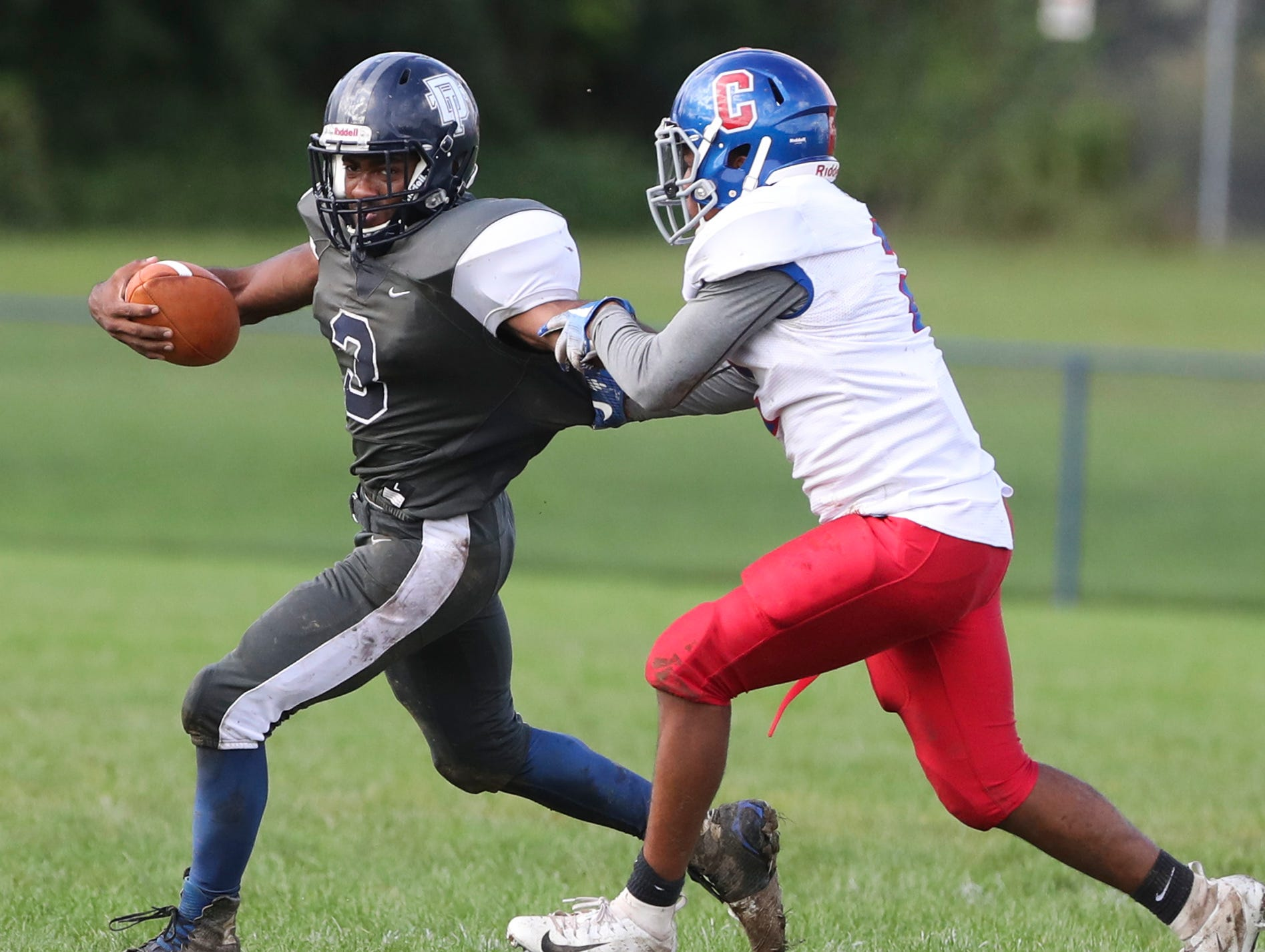 Delcastle's ChristianRichardson tries to avoid a Christiana defender in the first quarter at Delcastle Friday.