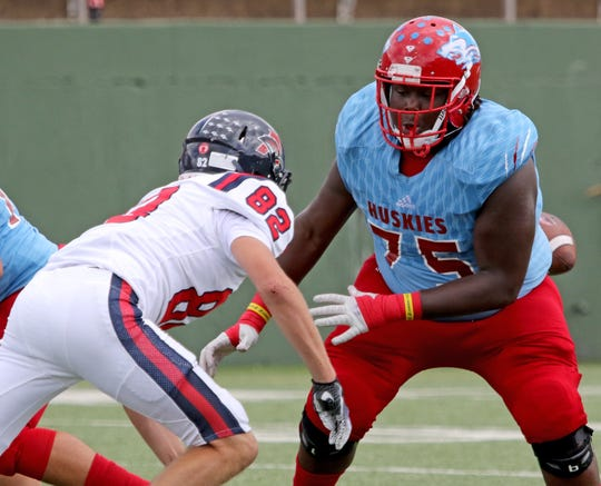 Hirschi's Johnny Taylor moves to block Aubrey's Jackson Fetters Saturday, Sept. 29, 2018, at Memorial Stadium. The Huskies defeated Aubrey 34-10 for their third straight win.