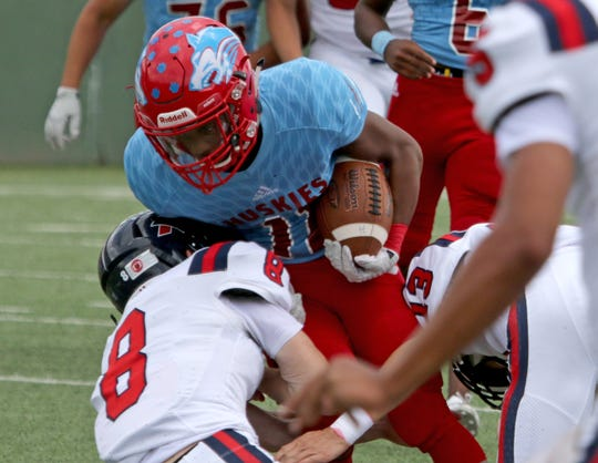 Hirschi's Jevione Livingston is tackled by Aubrey's Jackson Jennings Saturday, Sept. 29, 2018, at Memorial Stadium. The Huskies defeated Aubrey 34-10 for their third straight win.