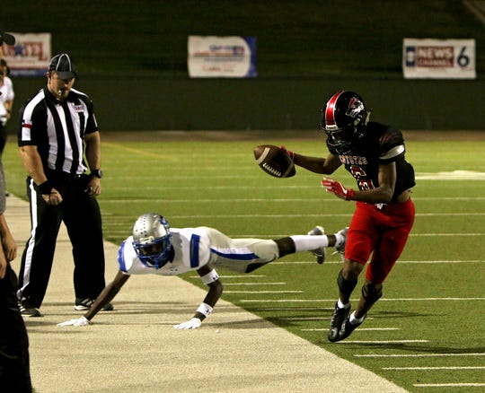 Wichita Falls High's A.J. Byrd (6) tiptoes the sideline after a catch over Lubbock Estacado's Kezadrick Murray on Friday, Sept. 28, 2018, at Memorial Stadium.