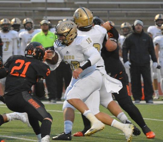 Rider quarterback Jacob Rodriguez tries to find room to run past Dumas' Evan Judd (21) Friday, Sept. 28, 2018, in Dumas.