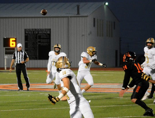 Rider quarterback Jacob Rodriguez throws a pass to Noah Randall (16) against Dumas Friday, Sept. 28, 2018, in Dumas.