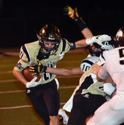 Quanah's Troy Conner (10) attempts to make a tackle during a game against Archer City last season.