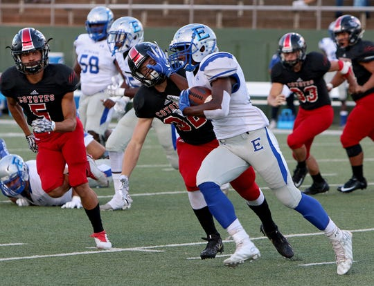 Lubbock Estacado's Jermiah Dobbins (right) stiff arms Wichita Falls High's Baylen Faris (32) during a rush on Friday, Sept. 28, 2018, at Memorial Stadium.