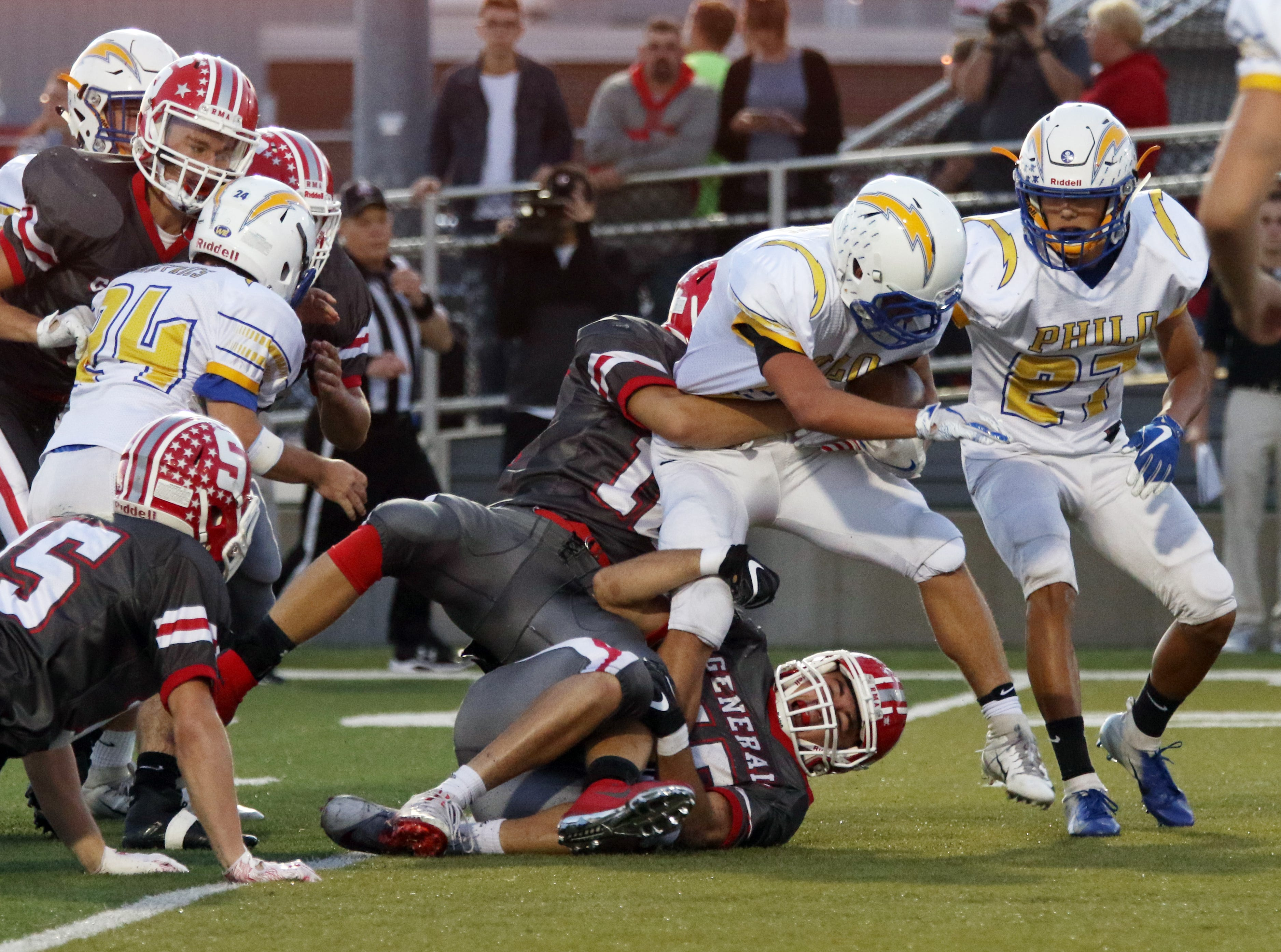 A pair of Generals defenders tackle a Philo ball carrier.