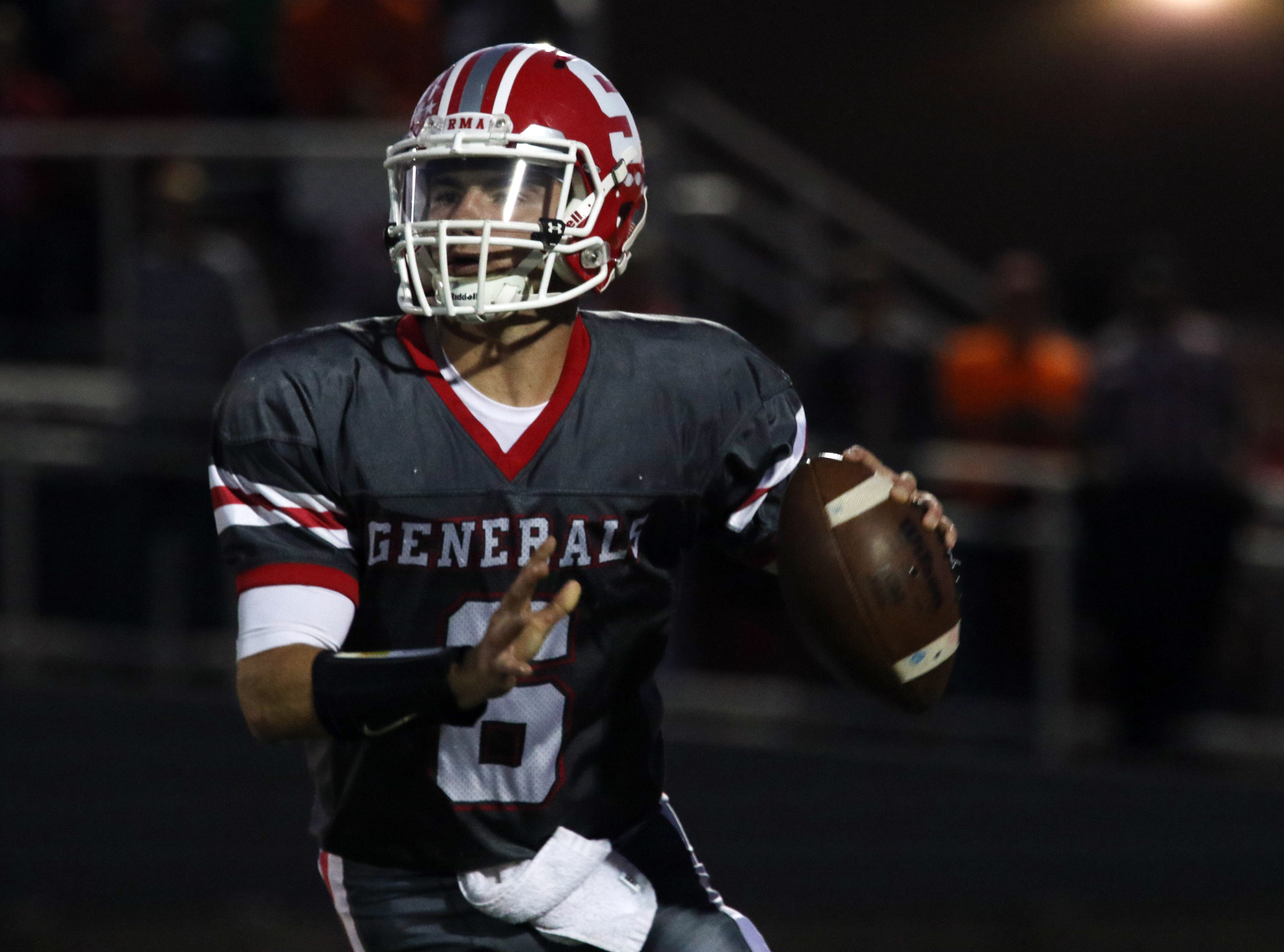 Sheridan's Ethan Heller gets ready to pass against Philo.