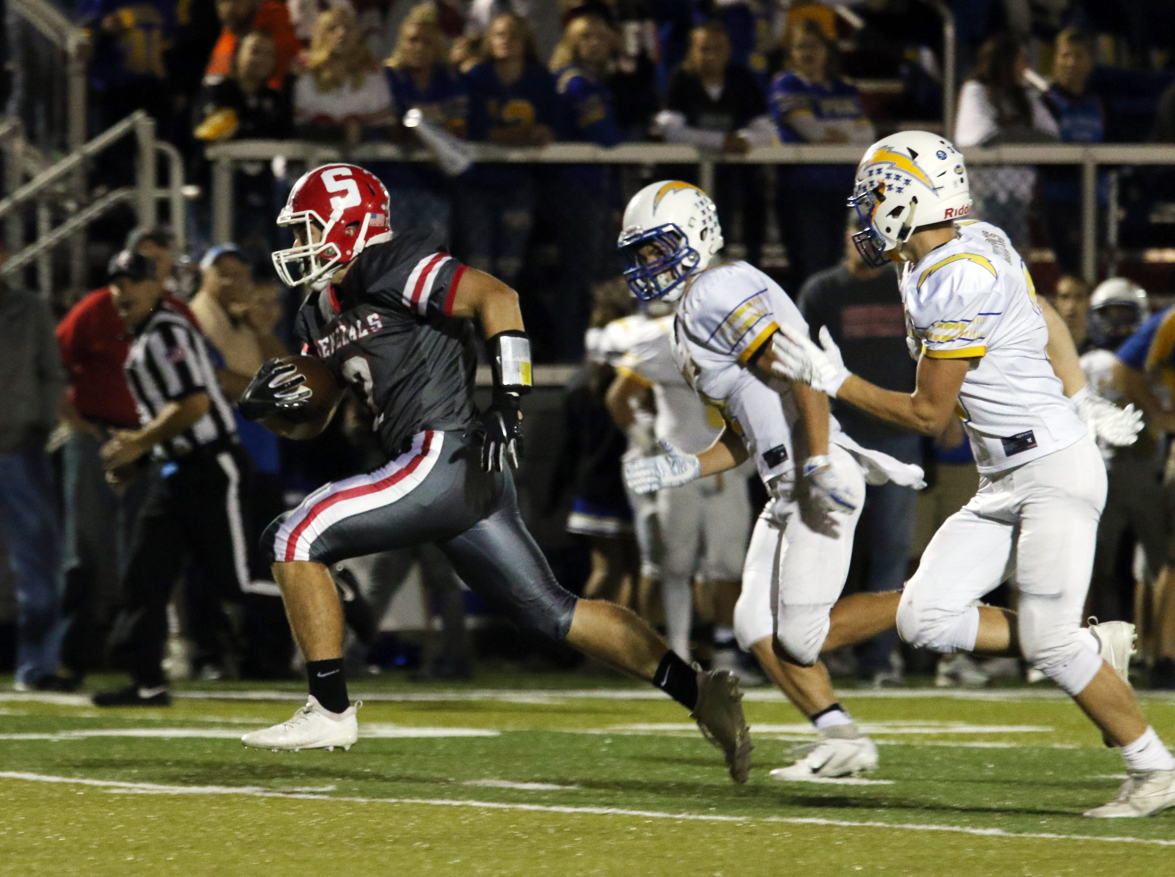 Sheridan's Will Hamilton races toward the endzone for a touchdown againt Philo.