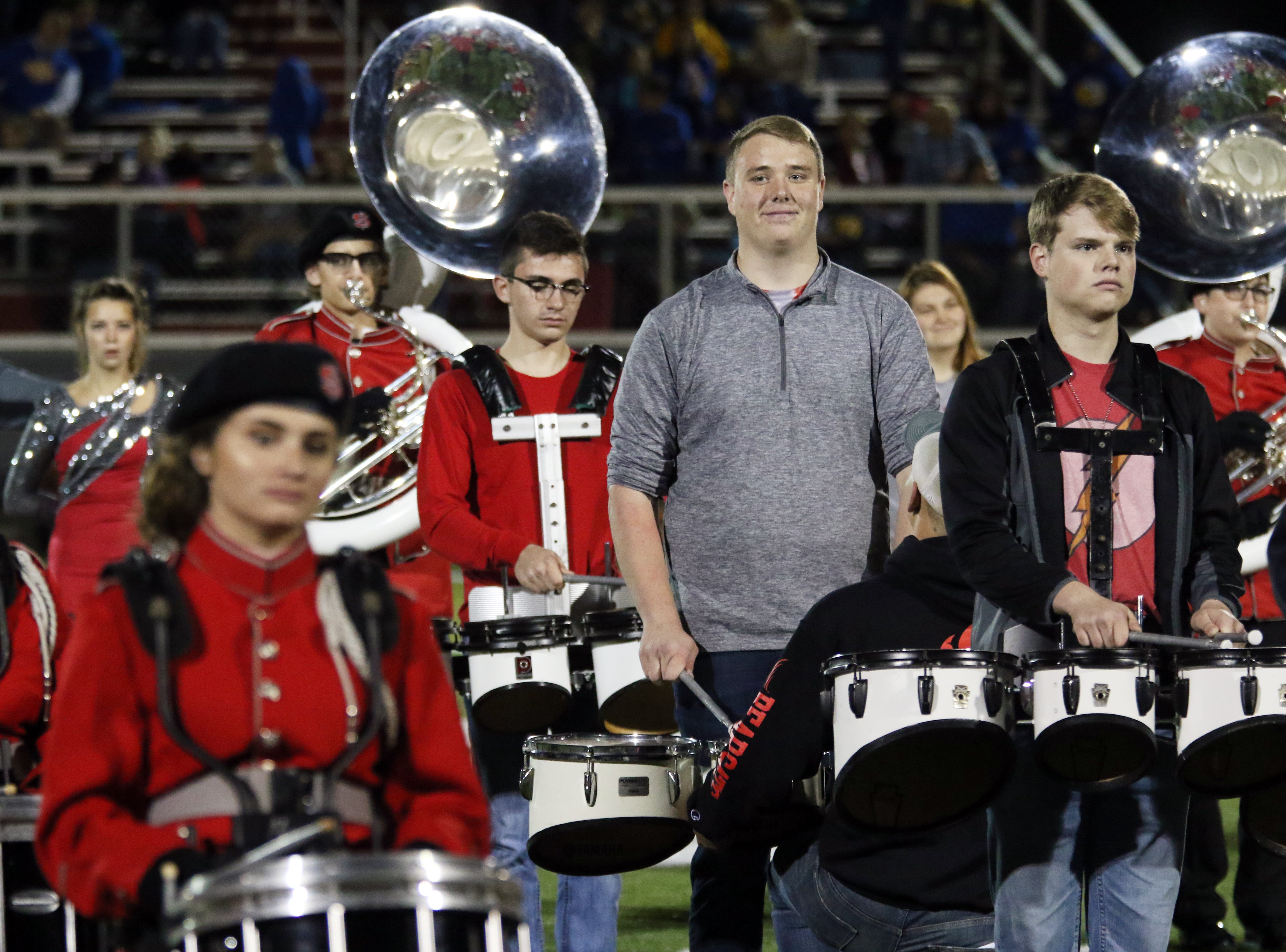 The Sheridan High School marching band, with help from alumni performs during halftime of Friday's game against Philo.