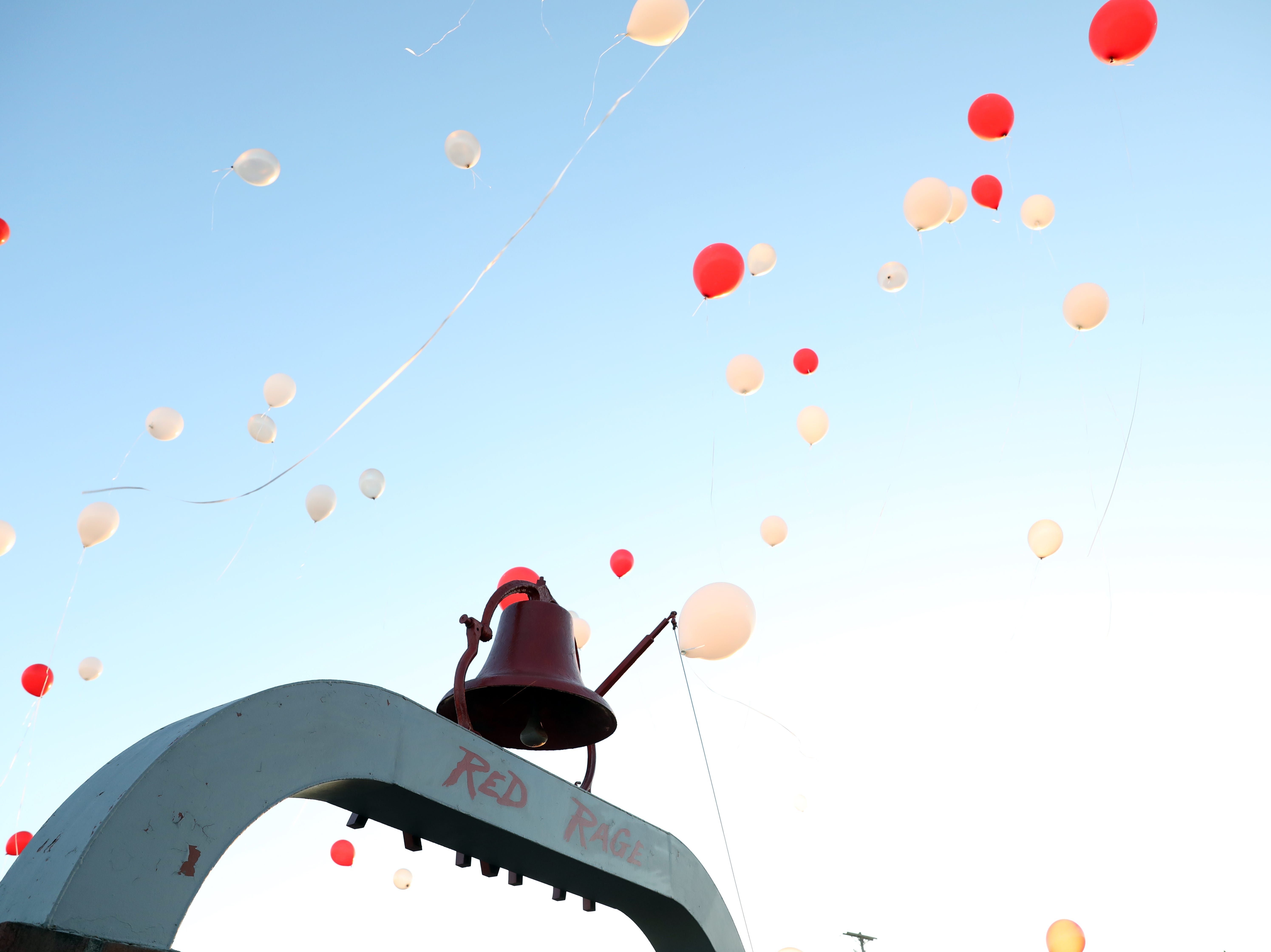 Balloons soar into the sky for Sheridan High School's homecoming on Friday.