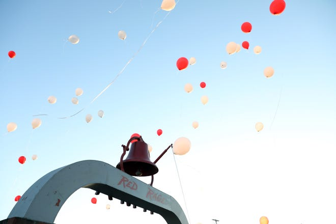 Balloons soar into the sky during a previous homecoming celebration.