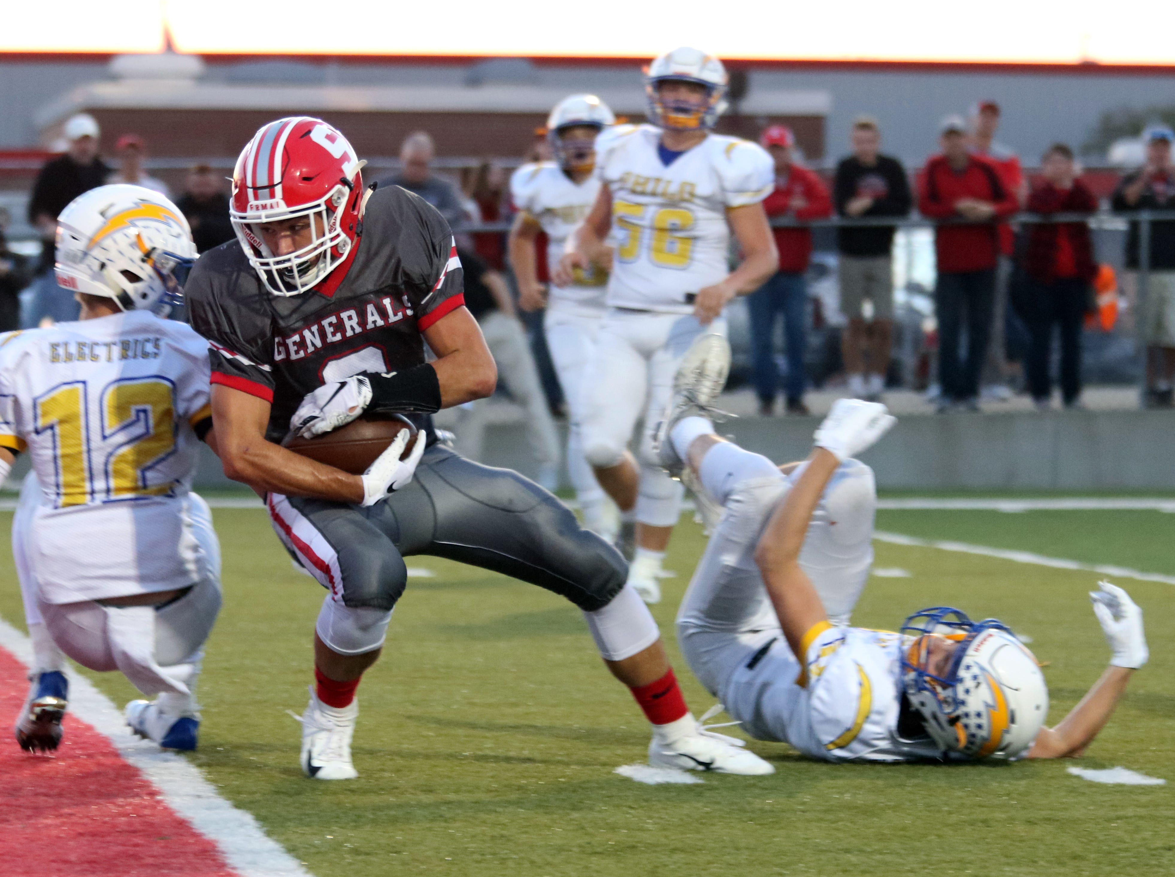 Sheridan's Cole Casto dives into the endzone with a touchdown against Philo.