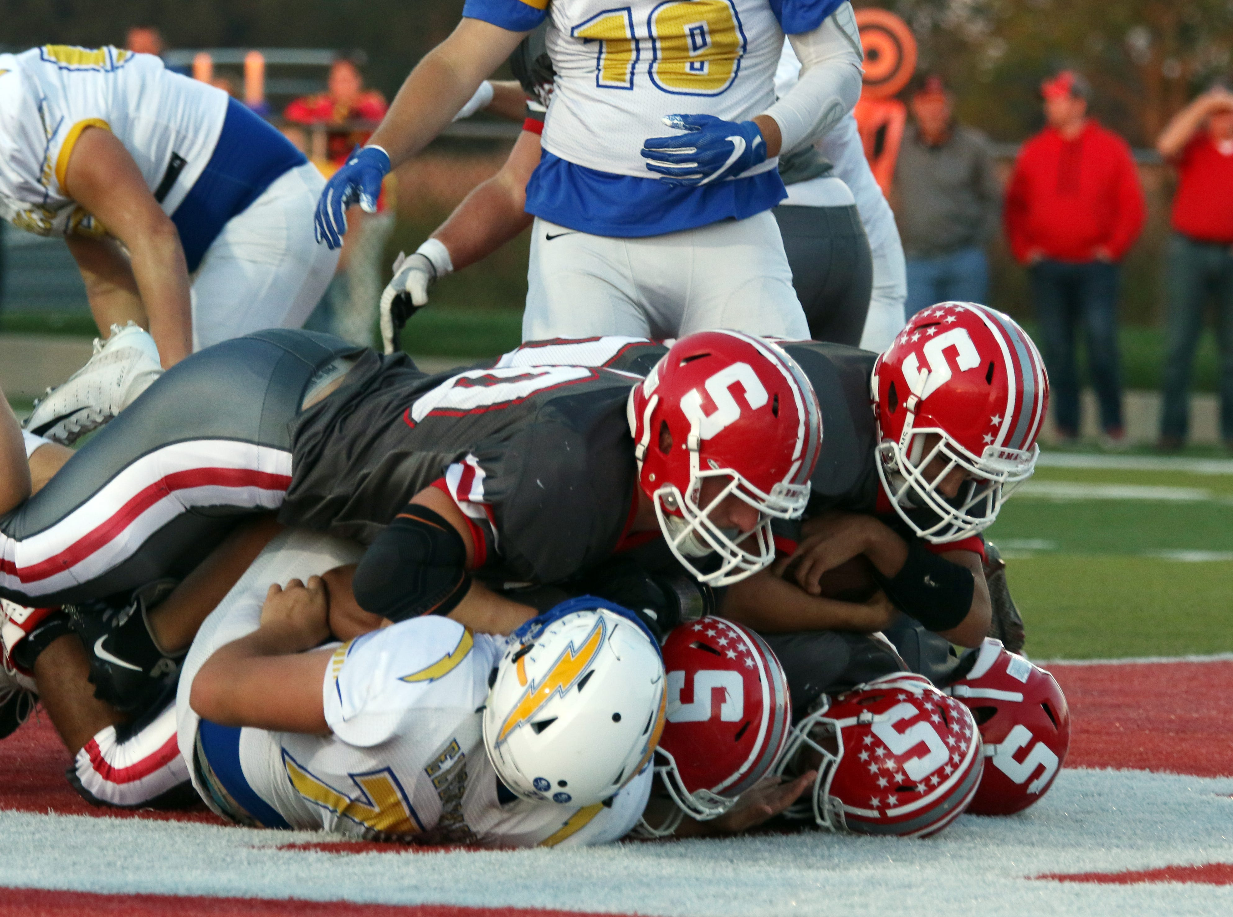 Sheridan's Isaiah Austin tumbles into the endzone for a touchdown against Philo.