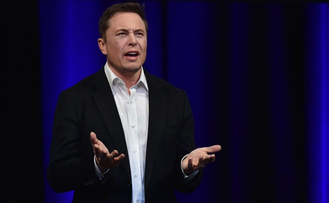 In this file photo taken on September 29, 2017, billionaire entrepreneur and founder of SpaceX Elon Musk speaks at the 68th International Astronautical Congress 2017 in Adelaide.