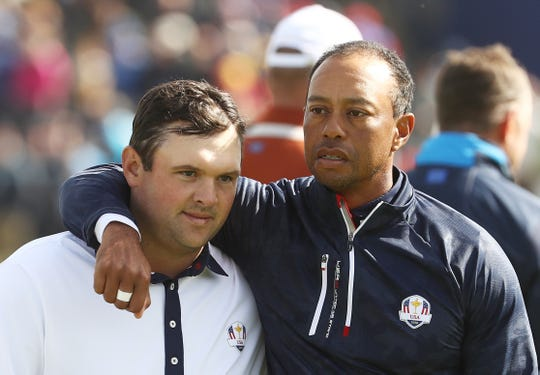 Tiger Woods consoles Patrick Reed following defeat during the morning fourball matches of the 2018 Ryder Cup at Le Golf National.