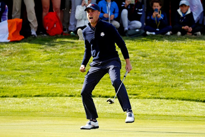 United States golfer Justin Thomas reacts to winning his match on the 17th green during the Ryder Cup Saturday morning matches at Le Golf National.