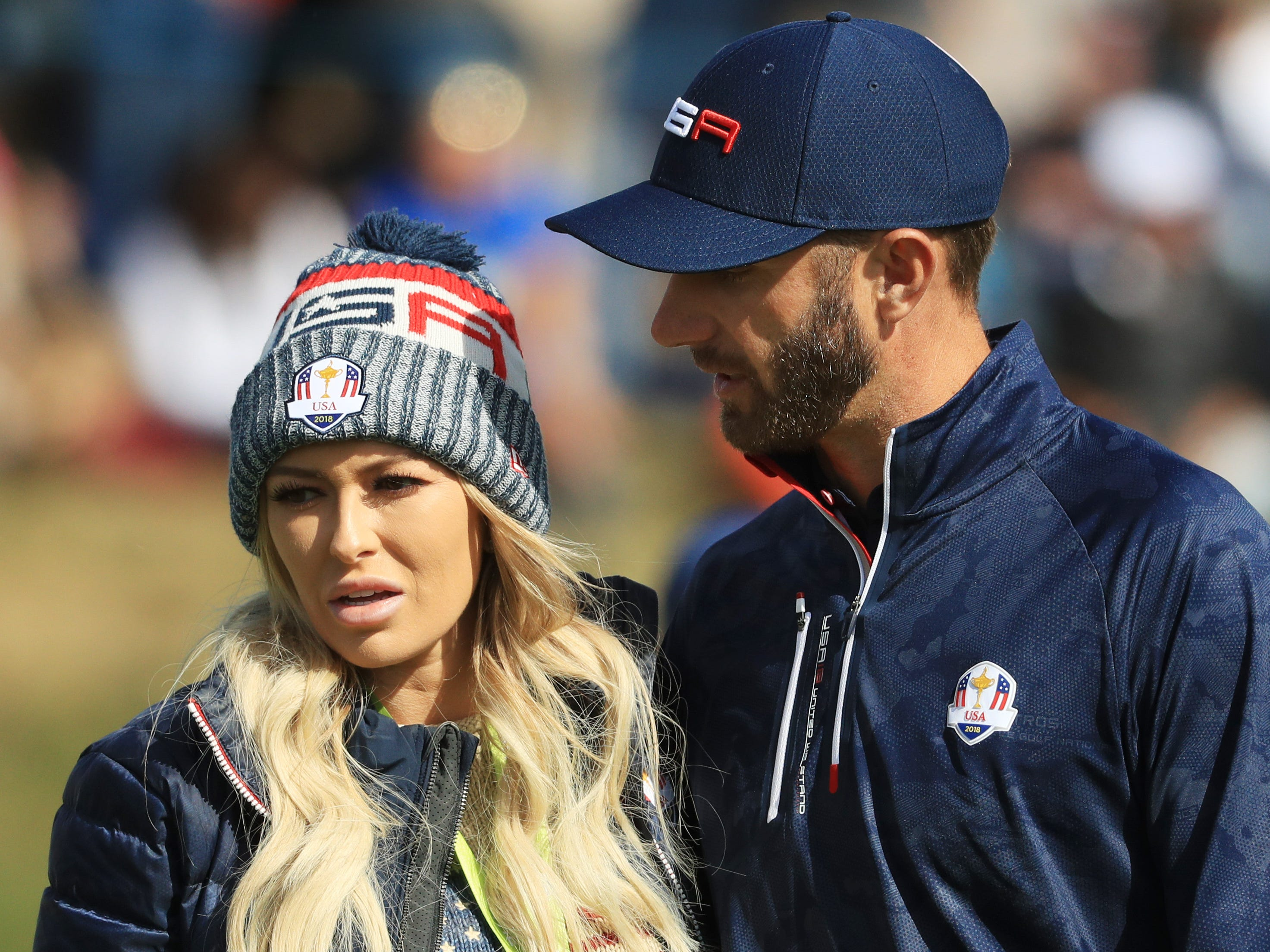 Dustin Johnson and his girlfriend, Paulina Gretzky, walk together after he lost his morning fourball match on Saturday.