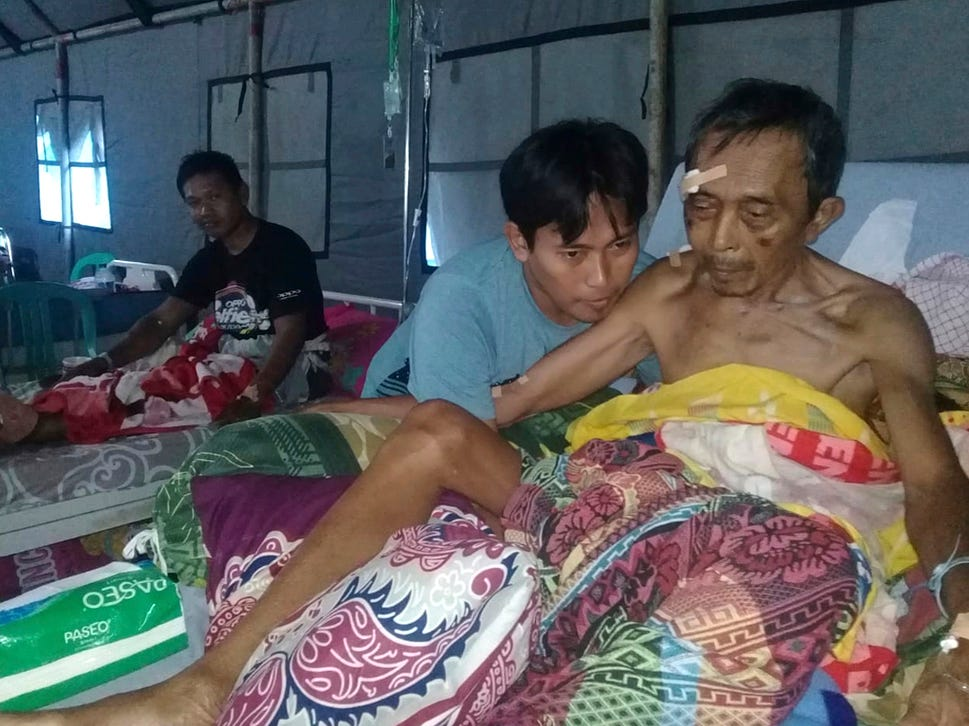 Earthquake-affected patients are treated at a makeshift hospital in Poso, Central Sulawesi, Indonesia.