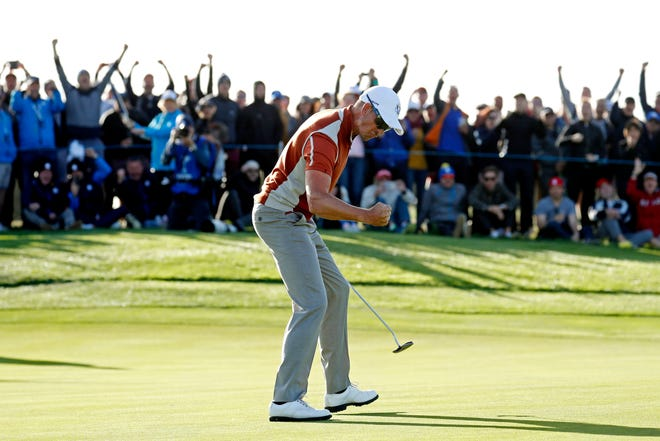 Henrik Stenson celebrates winning his match on the 17th green during the Ryder Cup afternoon matches at Le Golf National.