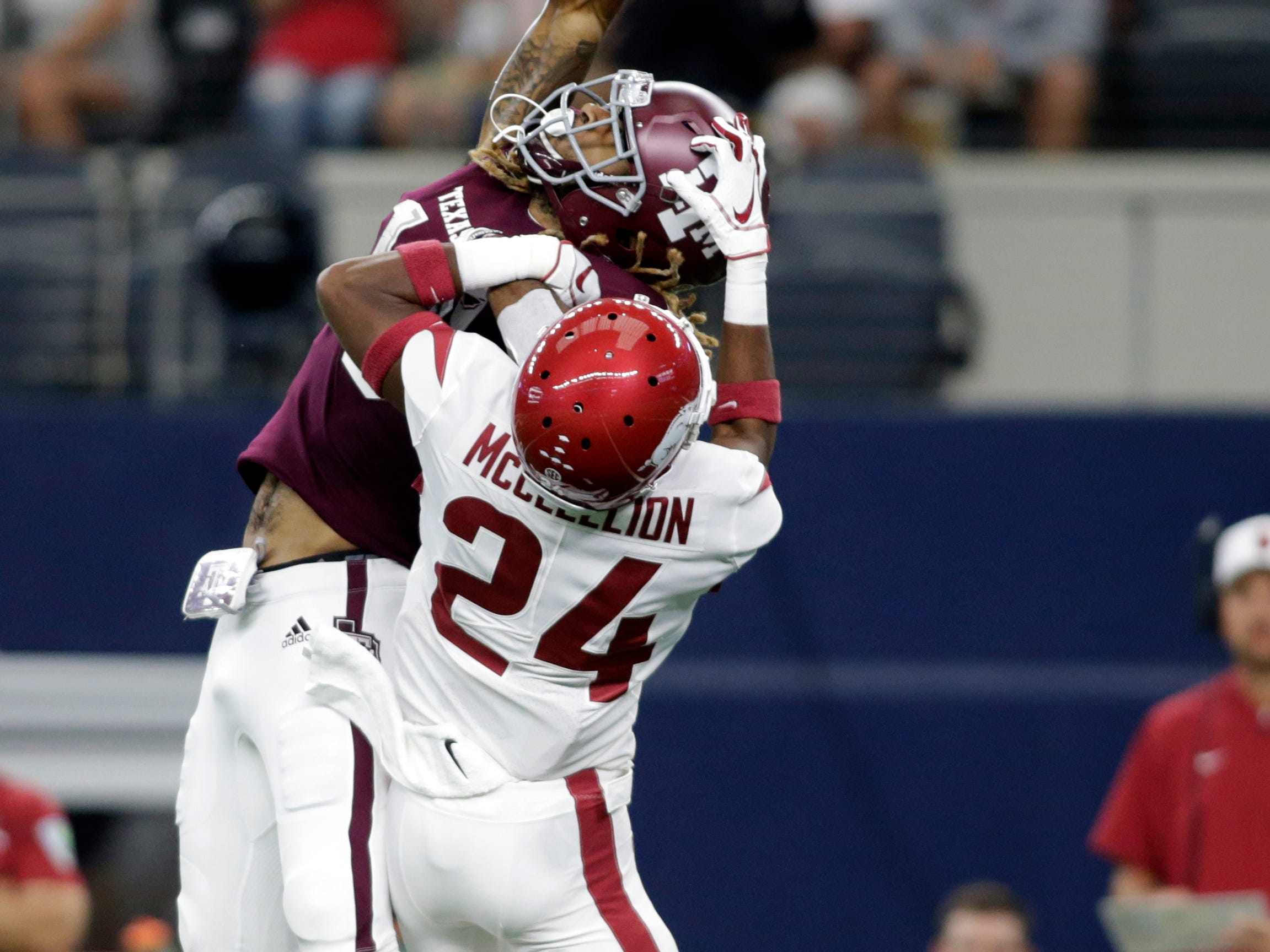 Arkansas Razorbacks defensive back Jarques McClellion (24) is called for pass interference against Texas A&M Aggies wide receiver Kendrick Rogers (13) in the first quarter at AT&T Stadium.