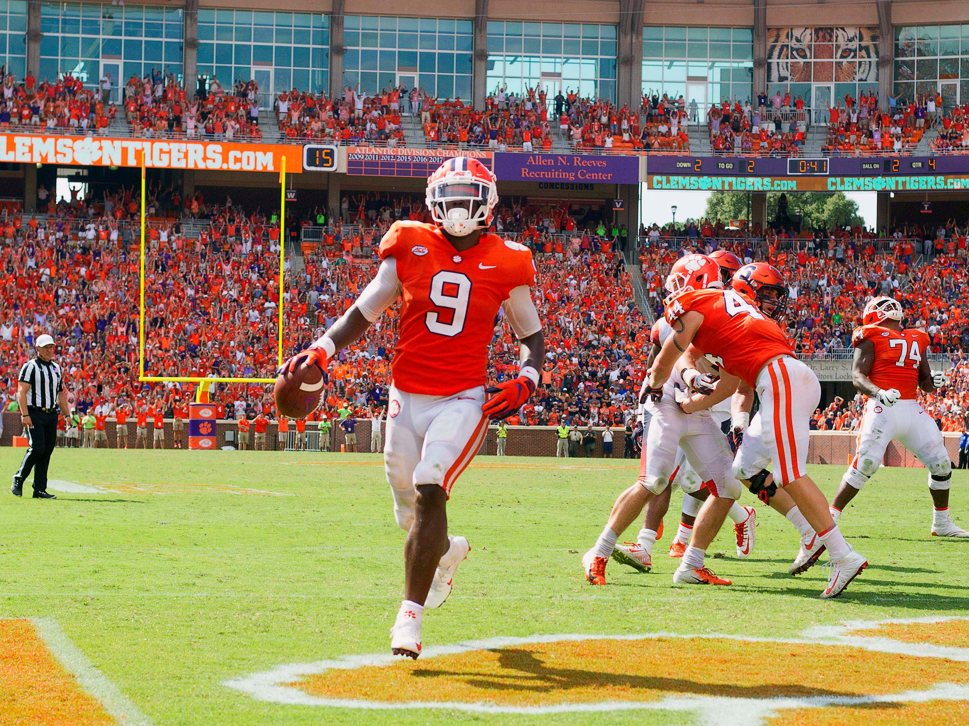 Clemson Tigers running back Travis Etienne (9) scores a touchdown during the second half against the Syracuse Orange at Clemson Memorial Stadium.
