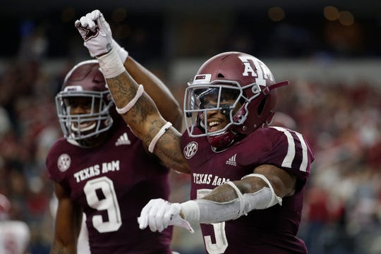 Texas A&M Aggies running back Trayveon Williams (5) celebrates after scoring a touchdown against the Arkansas Razorbacks in the fourth quarter at AT&T Stadium.
