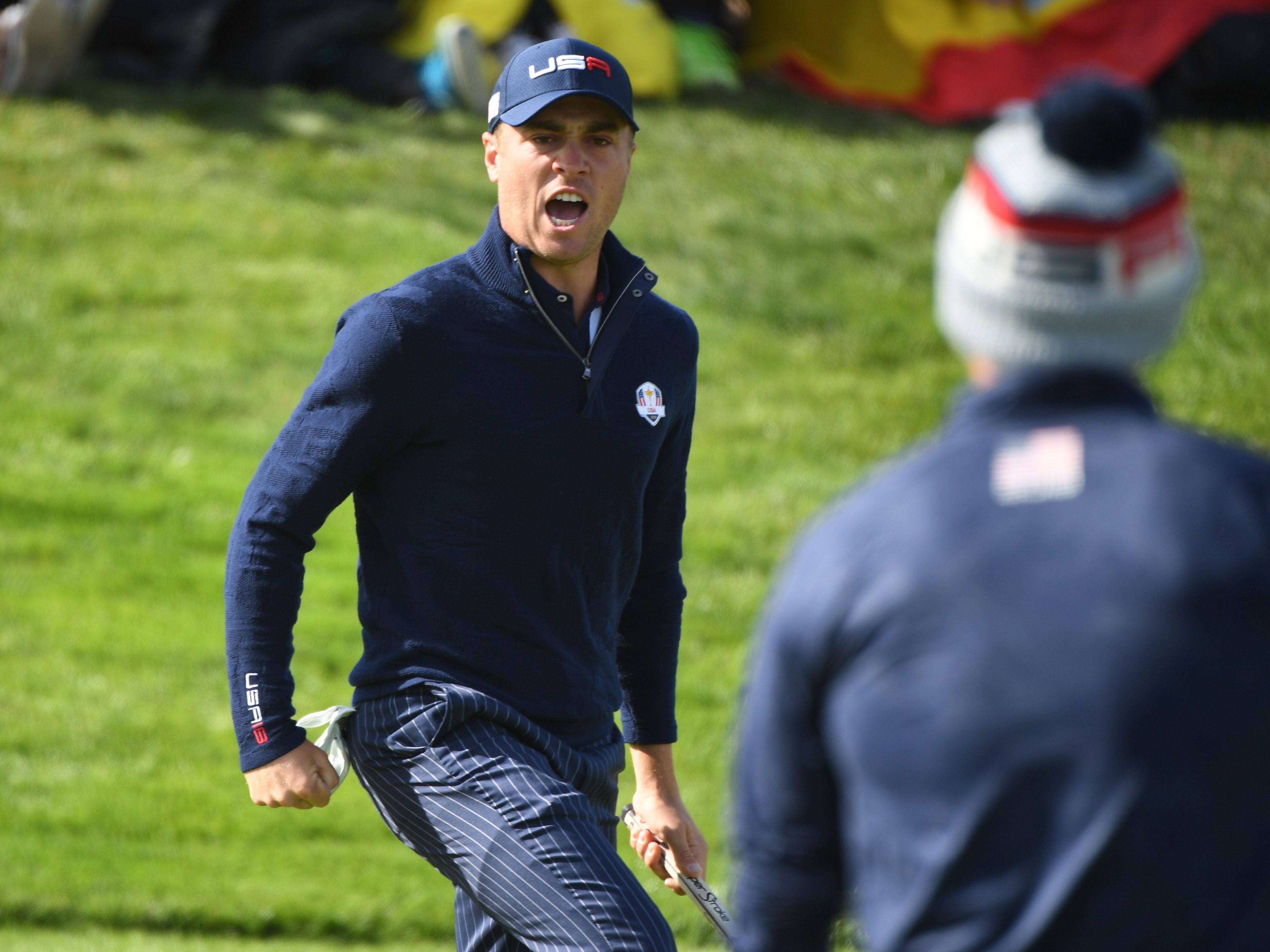 Justin Thomas exults after sinking a putt to win his early fourball match on Saturday with Jordan Spieth. They defeated Ian Poulter and John Rahm 2 and 1.